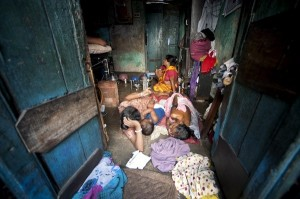 """An illustration of a poor family in Kolkata, West Bengal, India- """"Family in Kolkata Slum"""" by United Nations Photo is licensed under CC BY-NC-ND 2.0"""